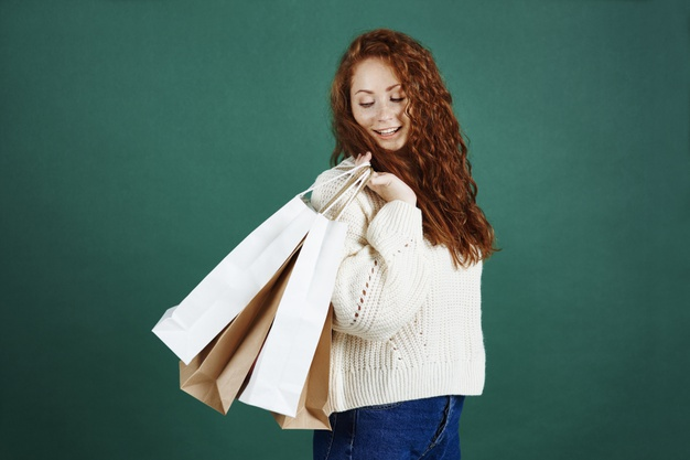 happy-girl-with-shopping-bags-studio-shot_329181-7358
